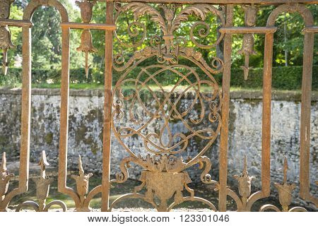 iron gate in an old nineteenth century style garden in Spain