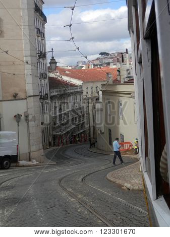 LISBON, PORTUGAL MARCH 15TH. Tramlines winding through narrow Lisbon street. Lisbon Portugal March 15th 2016