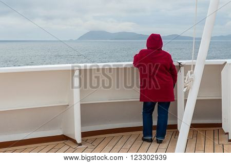 Cape Horn Chile - December 11 2012: Passenger on board the cruise ship Veendam looking forward on the bow on Cape Horn Chile.