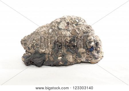 bornite crystal mineral sample in granite with many facets