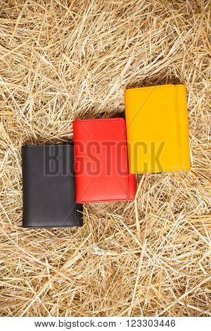colorful purses in the hay, top view