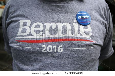 NEW YORK - MARCH 17, 2016: Presidential candidate Bernie Sanders supporter wears t-shirt and button with sign Bernie 2016. The US presidential election of 2016, scheduled for Tuesday, November 8, 2016