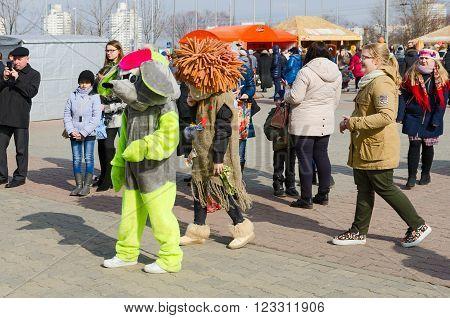 GOMEL BELARUS - MARCH 12 2016: Growth dolls at Shrovetide festivities Gomel Belarus
