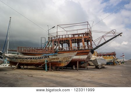 ALANYA TURKEY - JULY 09 2015: Repair of motor boats. Shipyard in Alanya harbor. Alanya - a popular holiday destination for European tourists.