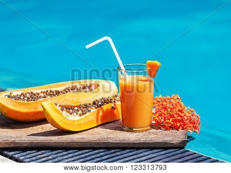 papaya juice lying by the pool. Summer time