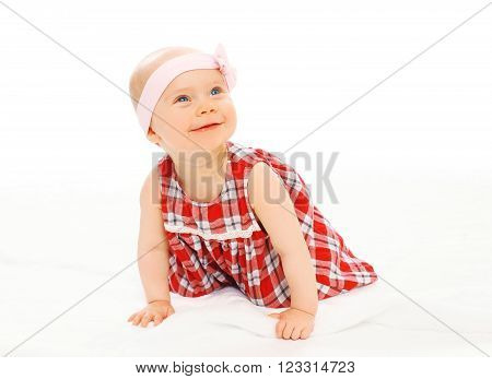 Portrait Of Cute Smiling Baby In Dress With Headband Crawls