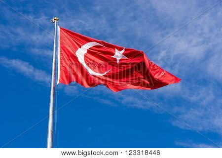 Turkish flag waving in blue sky Izmir TURKEY