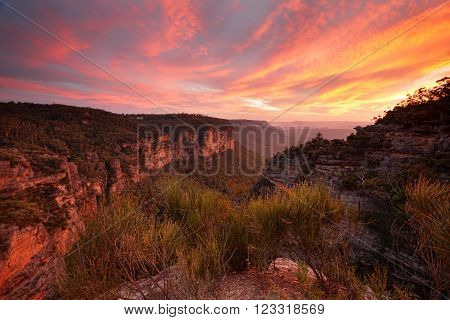 Magnificent views and spectacular sunset from Norths Lookout in Katoomba named after John Britty North founder of coal mining in Katoomba. Reds of the sky are reflected back into the landscape. The colours were intense and vibrant
