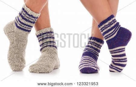 Pair of man and woman in the knitted socks over white background