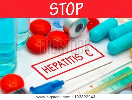 Stop hepatitis c. Vaccine to treat disease. Syringe and vaccine with drugs.