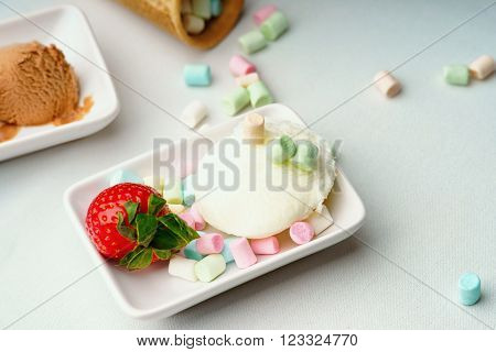 Ice cream sundae, strawberry and colorful candies