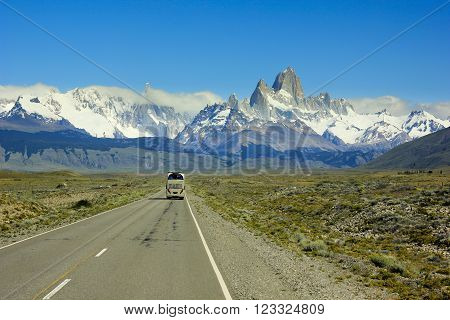 big bus going on asphalt road to mountain Fitz Roy in Argentina Patagonia