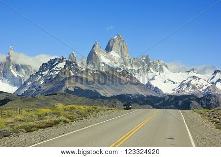 car standing on asphalt road to mountain Fitz Roy in Argentina Patagonia