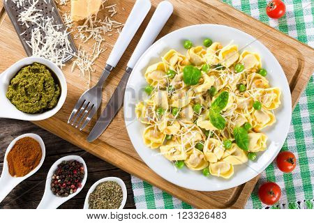 tortellini with green peas Pine nuts parmesan cheese and grater