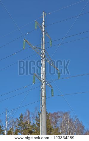 Tower power lines. Photo of towers of transmission lines against the blue sky.