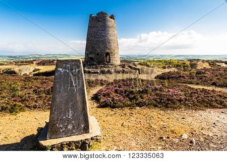 Triangulation point and derelict windmill. Parys Mountain Amlwch Anglesey Wales United Kingdom