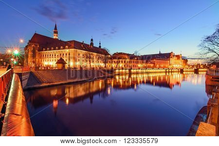 The promenade of Wroclaw view from river Odra after sunset. Poland Europe.