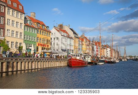 COPENHAGEN, DENMARK - AUGUST 25: Unidentified people enjoying sunny weather on the famous Nyhavn promenade on August 25, 2010 in Copenhagen, Denmark. Nyhavn district is famous landmark of Copenhagen.