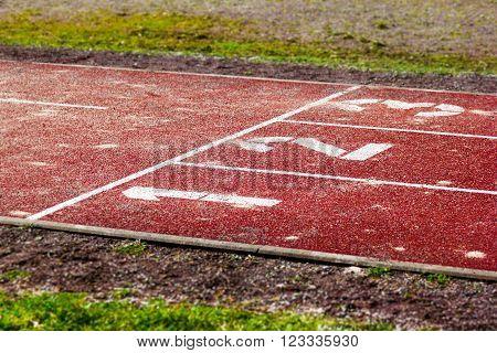 white start position on red tartan track