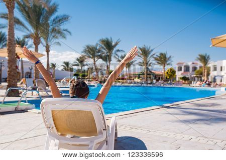 woman lying on a lounger by the pool. Relax on the sea