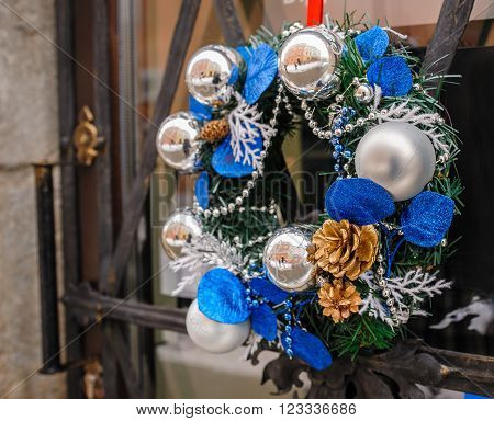 Wreath decoration at door for Christmas holiday.