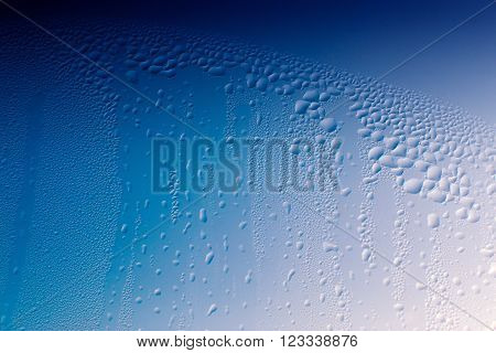 Condensation On A Window With Blue Background
