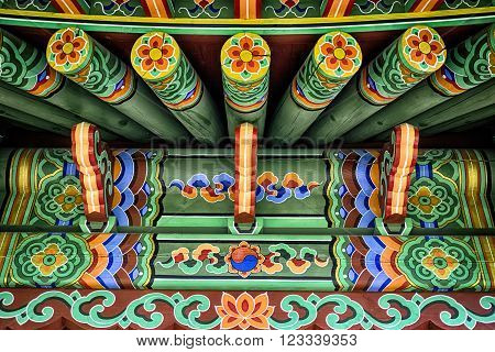 Green Chinese ethnic painted wooden blockhouse background HDR effect