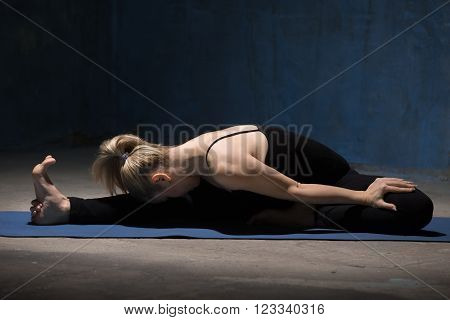 Beautiful Yoga Woman Sitting In Head To Knee Forward Bend Pose
