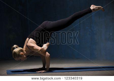 Beautiful Yoga Woman Standing In Eka Pada Galavasana Pose