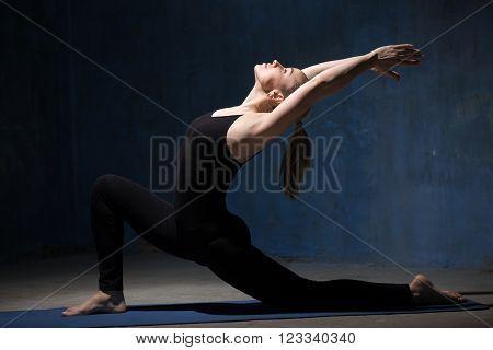 Beautiful Yoga Woman Doing Anjaneyasana Pose