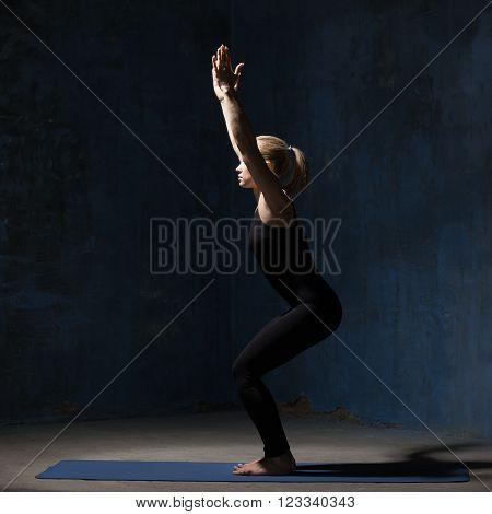 Beautiful Yoga Woman Standing In Chair Pose