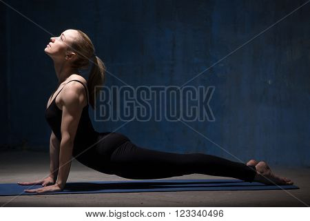 Beautiful Yoga Woman Doing Upward Facing Dog Pose