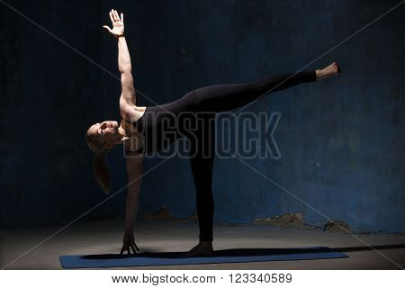 Beautiful Yoga Woman Doing Half Moon Pose
