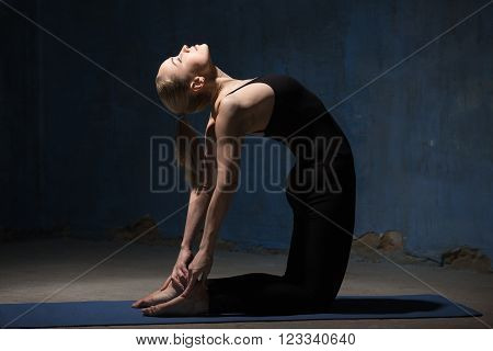 Beautiful Yoga Woman Doing Ustrasana Pose