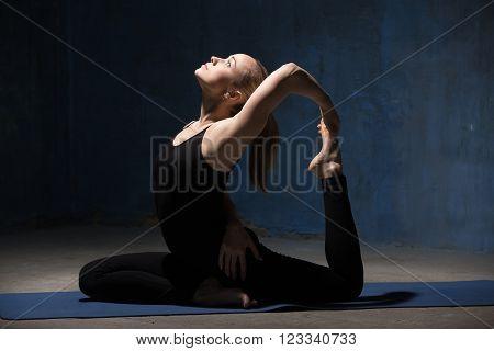 Beautiful Yoga Woman Sitting In One-legged King Pigeon Pose