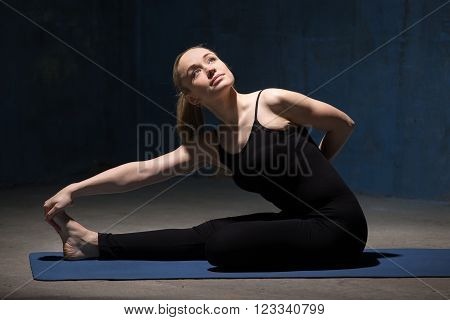 Beautiful Yoga Woman Sitting In Half Bound Lotus Forward Bend
