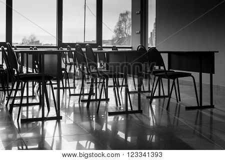 Rows Of Empty Conference Chairs And Shadows