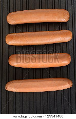 top view cooking sausages on bbq grill