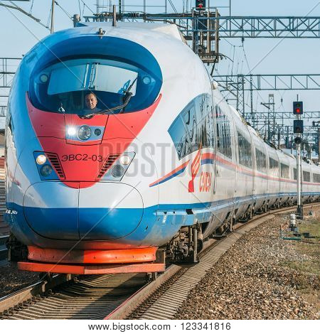 Moscow Russia - September 19 2015: Modern high-speed train moves from the station after departure at sunset time.