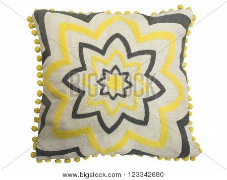 Decorative cushion with geometrical pattern of yellow and black threads embroidered isolated on white background.
