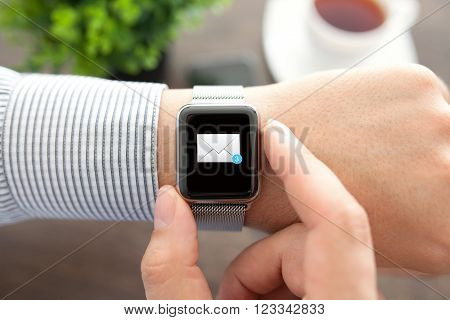 Man hand with smart Watch and mail on the screen