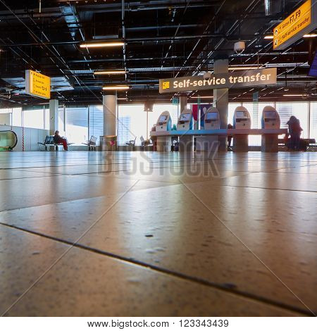 Amsterdam, Netherlands - March 11, 2016: self check-in kiosk in Amsterdam Airport Schiphol. Amsterdam Airport Schiphol is the main international airport of the Netherlands.