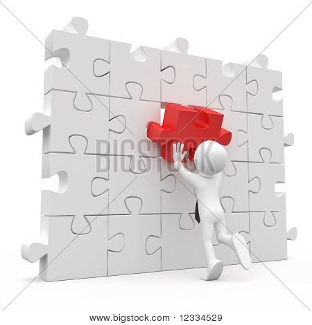 Man with tie, putting on a wall a red piece missing