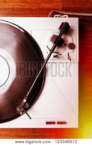 turntable record player in focus. Analog audio technology useful for DJ, hipster or audio enthusiast.