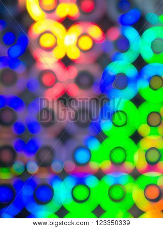 Green blue red yellow blurred circle lights background