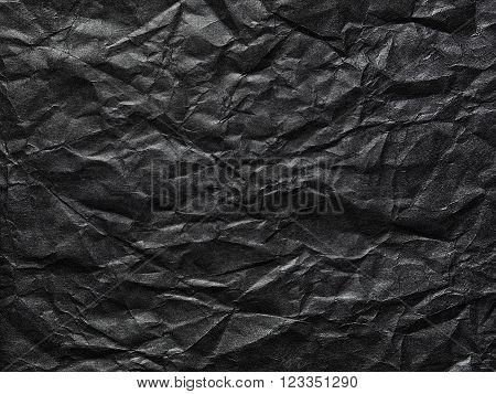 the Black crumpled paper as a background