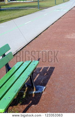 Close up of Green bench and bicycle path in Annecy, France