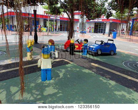 JOHOR MALAYSIA  - NOVEMBER 11 2014:  News Reporter in Park at LEGOLAND Malaysia Theme Park November 11, 2014  in Johor, Malaysia
