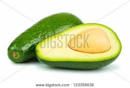 Whole and half avocado on white background