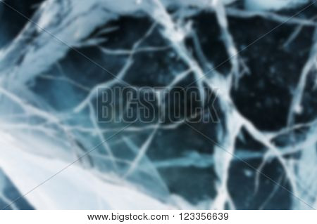 Abstract Blue River Ice With Large Cracks.